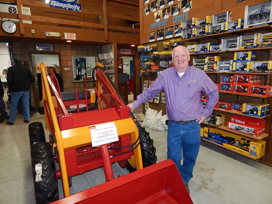 Bob Lano, president and co-owner, Lano Equipment, stands with the latest addition to the show room floor, a Melroe M400, the original precursor of today's famous Bobcat loader.