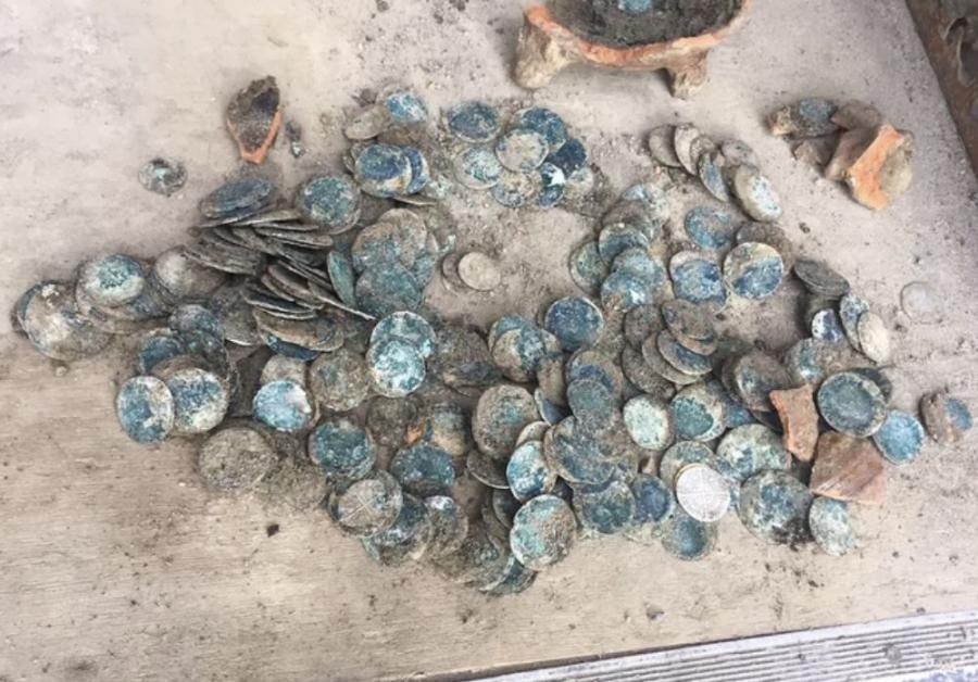 A crew from Oasen, a drinking-water company, was working on a project in the new town of Hoef en Haag, when they discovered a glazed, earthenware pot of gold containing 500 coins. (Photo Credit: Oasen)