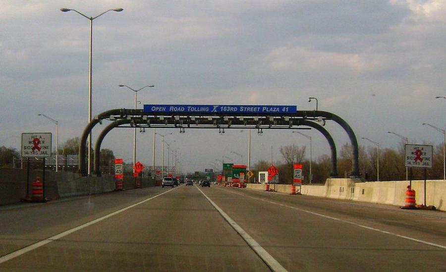 With electronic tolling, vehicles drive under toll gantries, which are equipped with cameras and computers to read the drivers' E-ZPasses or license plates.