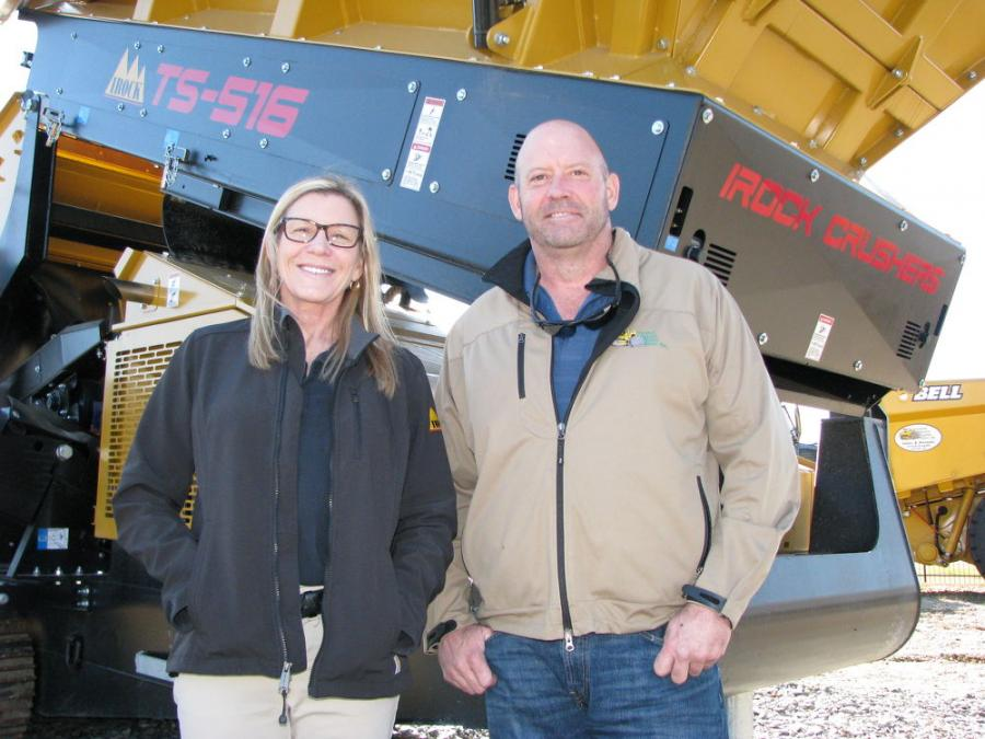 Marla Spooner Neise and Chuck Spooner, Central Atlanta Tractor owners, stand with one of their new IROCK machines on the yard in Austell, Ga.