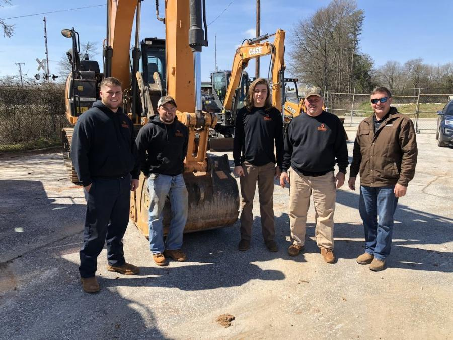 Woody Inman (R) of Hills Machinery goes over the features of the Case excavators with (L-R) Hollis Dobbins, Dylan Moore and Blake and Ben Dobbins, all of Dobbins Grading & Hauling in Landrum, S.C.