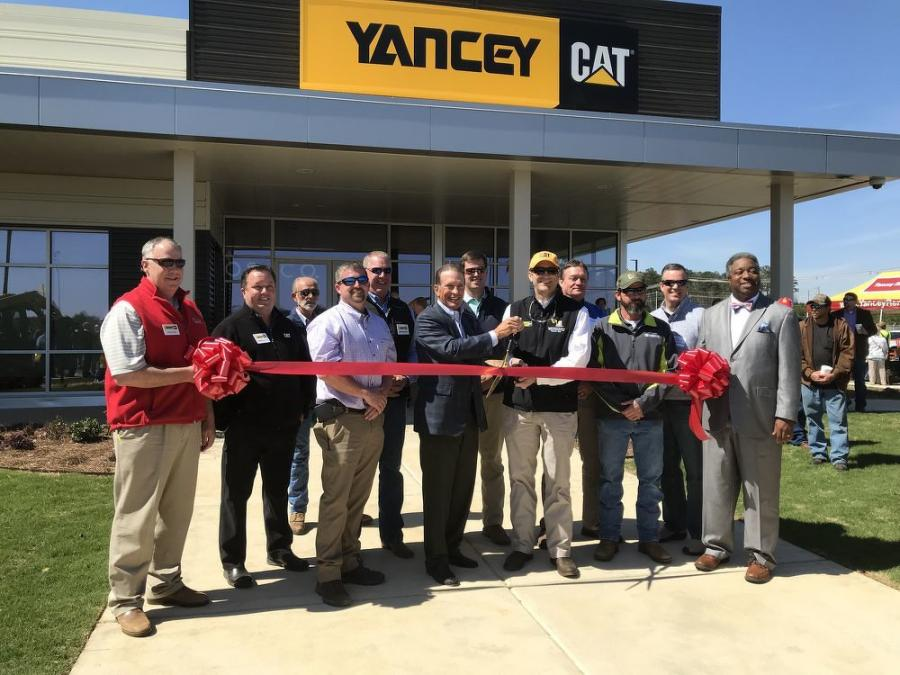 The official ribbon-cutting took place with Jim Stephenson, Yancey Bros. Co., chairman and CEO,  and Trey Googe, Yancey Bros. Co. president and COO, wielding the big scissors in the middle of this group and flanked by local dignitaries and key Yancey management members.