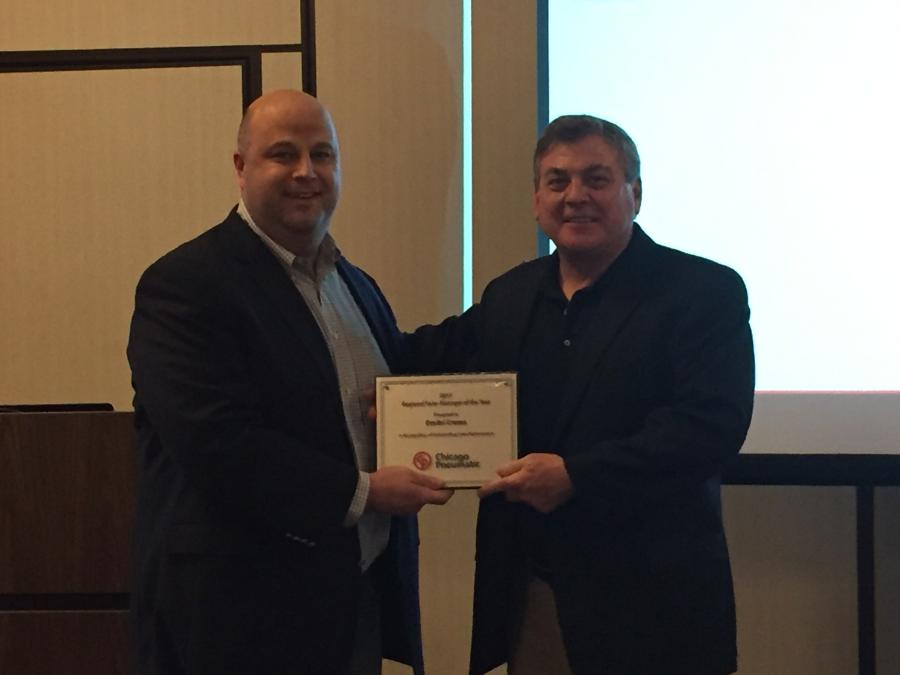 Jonathan Cook (L), vice president of sales at CP, presented Dmitri Cremo with the regional sales manager of the year award.