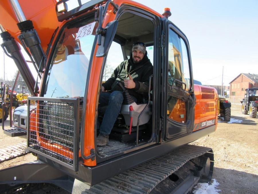 Jake Saxton, Saxton & Smith Excavating & Landscaping, tries out this Doosan DX 225LC excavator.