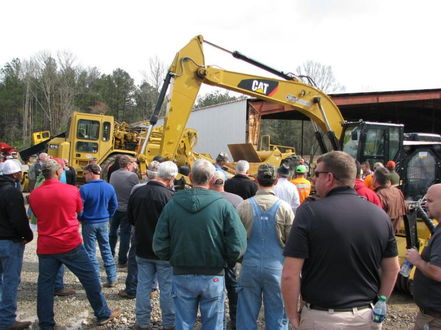 One of the stars of the show surrounded by a sea of bidders — a like-new 2016 Cat 326F L with only 600 hours on the meter.