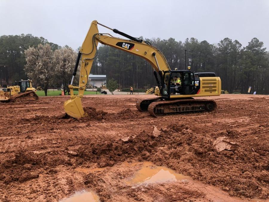One of the guests receives training on the Cat 336F excavator, equipped with Trimble's Earth Works grade control platform with the full automatics feature.