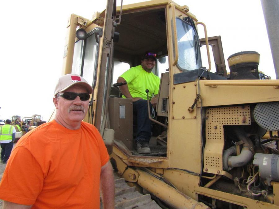 Father and son team, John (L) and Mathew Kelley of Riverside, Calif., look for some good quality used equipment for repair and resale — like this Caterpillar D4H crawler dozer.