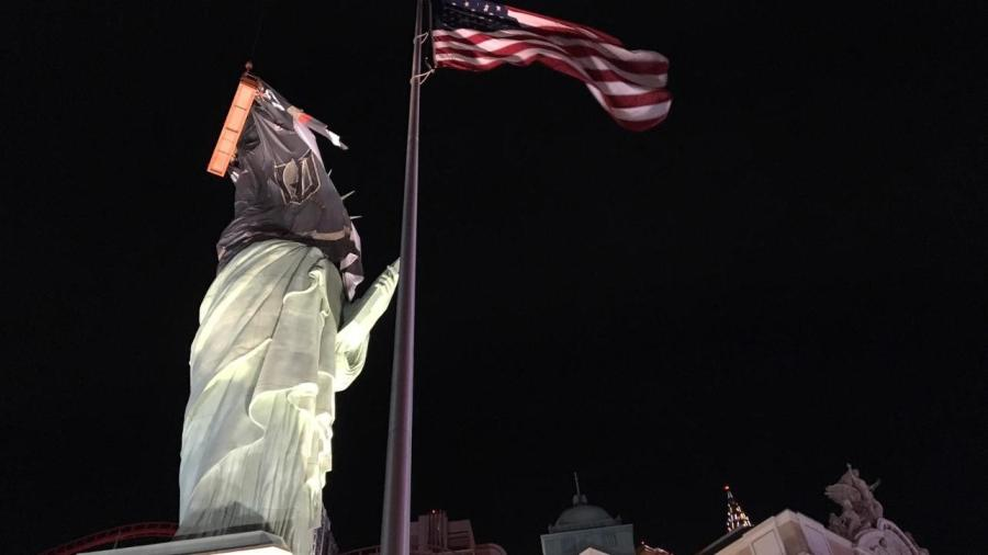 Work began on the project in the middle of the night between April 12 and April 13, when a crew of eight was suspended in two baskets supported by cranes to drape the statue in the 6,000-sq.-ft., 620-lb. jersey.