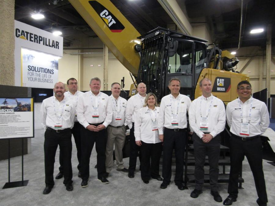 (L-R): Caterpillar's Justin Folwz, Pou Fabrizius, Todd Benson, Garry Monaghan, Ken Felcyn, Danielle Livengood, Vincent Migeotte, George Pinther and Hugo Pravena, introduce the Cat MH3026 purpose-built material handler with orange peel grapple. This model replaces the MH3024.