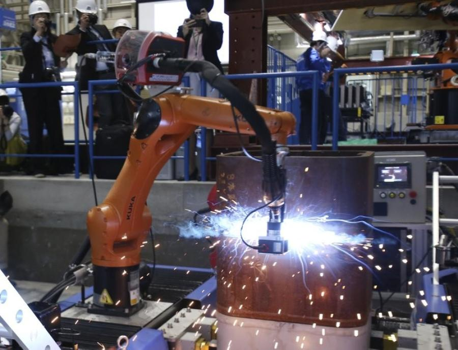 The Robo-Welder and Robo-Buddy, with twisting and turning mechanical arms, will be deployed at construction sites later this year, the company said.