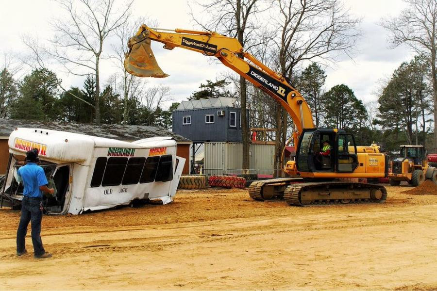Grun crushes a senior transport van with Diggerland's XL excavator. (Photo Credit: Diggerland USA)