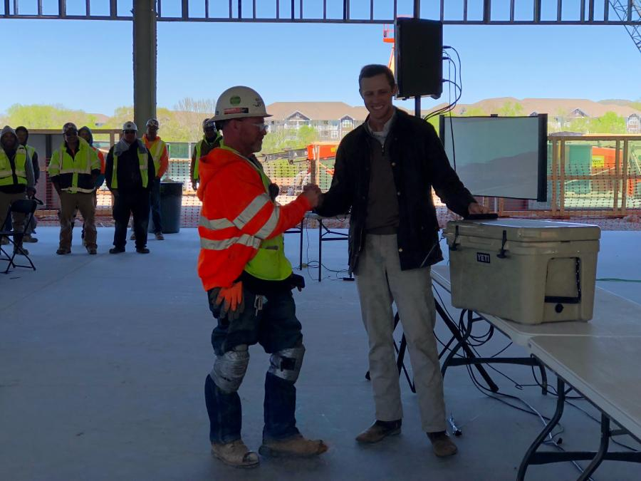 During a ceremony on April 20, construction crews celebrated the topping out milestone, which signals the completion of the final level of the facility's steel structure.