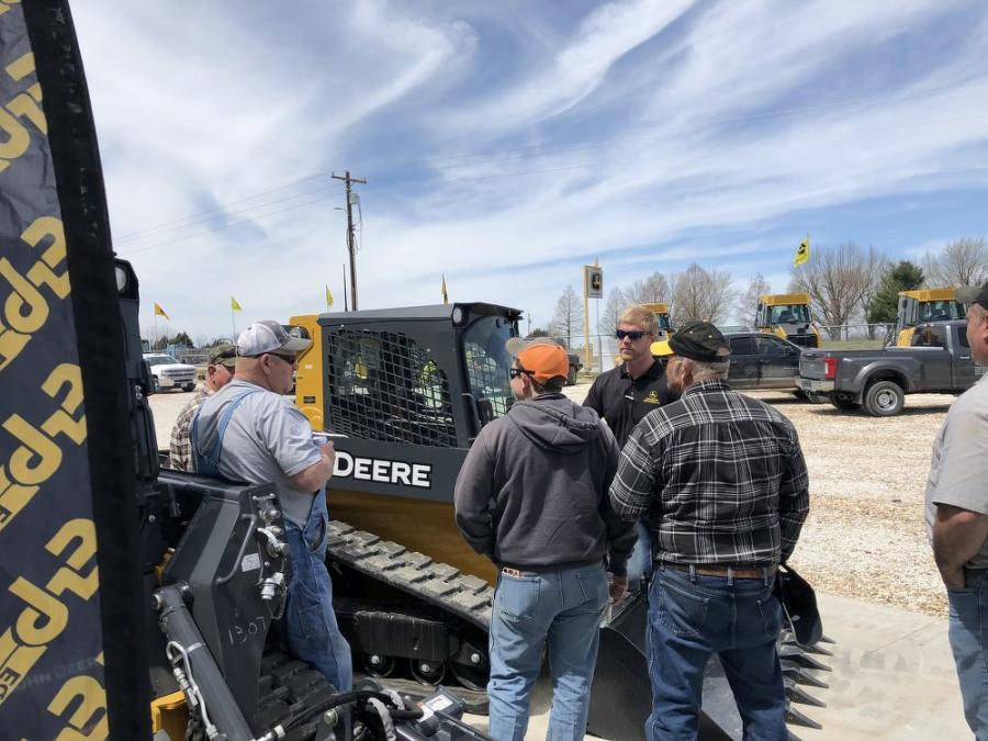 Salesman Dan Jones talked to some guests about a 323E compact track loader.