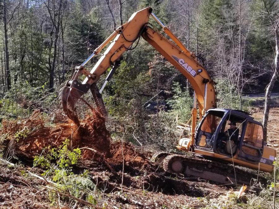 Brian Thompson is not only splitting and harvesting stumps, but also digging trenches for silt fence, loading log trailers and backfilling stump excavations with a Ransome Shark Tooth RST 150 stump splitter/harvester mounted on a Case CX160 hydraulic excavator.