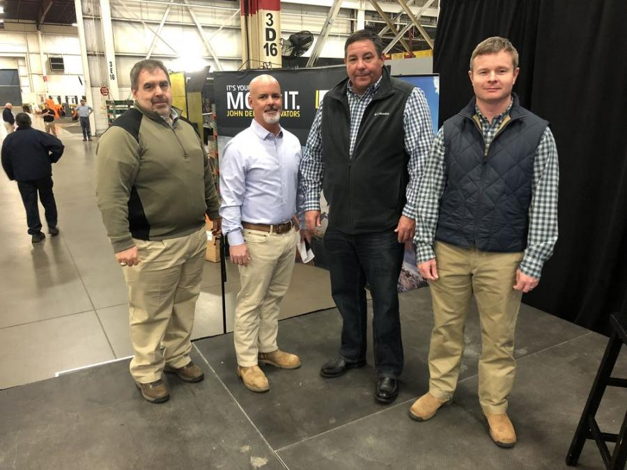 (L-R) are Terry Thomas, general manager, James River Equipment; Ted Doran, western North Carolina sales manager of James River Equipment; Kevin Champion, managing member of CK Contractors & Development; and Brian McManus, managing member of Hoopaugh Grading Company.