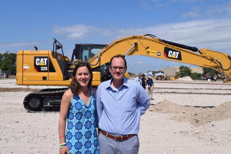 Katherine Kelly, vice president of product support, and Chris Kelly, senior vice president, both of Kelly Tractor, stand in front of this Caterpillar 320 Next Gen excavator.