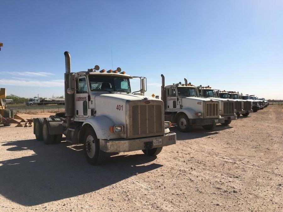Several day cab truck tractors are lined up and ready for the auction.
