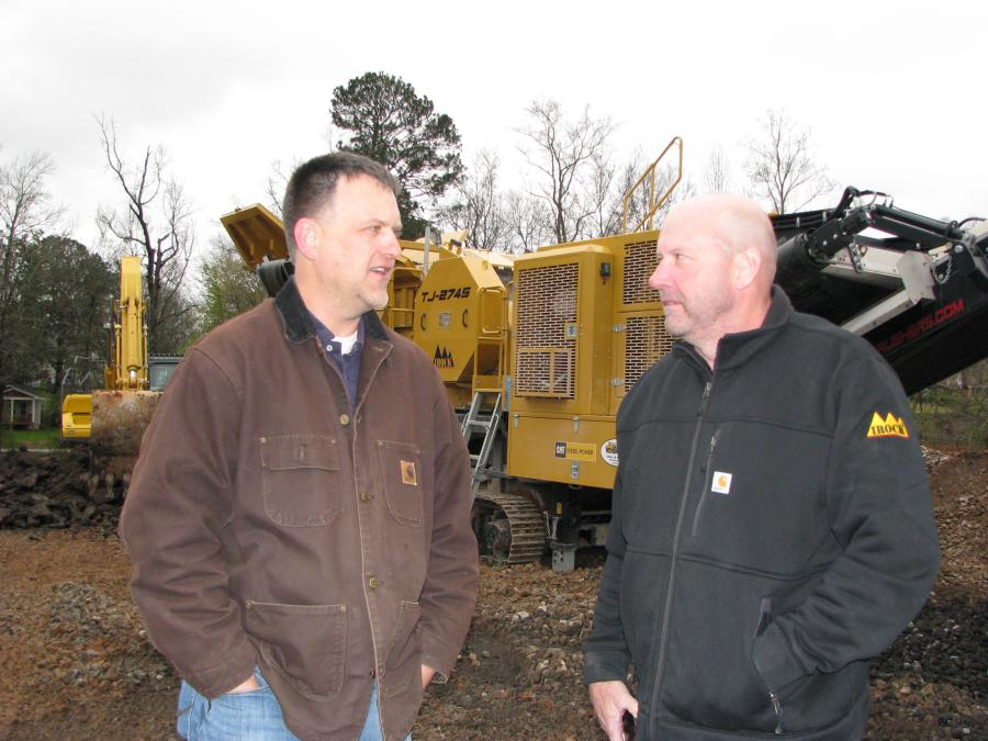 Southern Demolition's Matt Ragsdale (L) and Central Atlanta Tractor's Chuck Spooner discuss the IROCK machine at work on a crushing project.