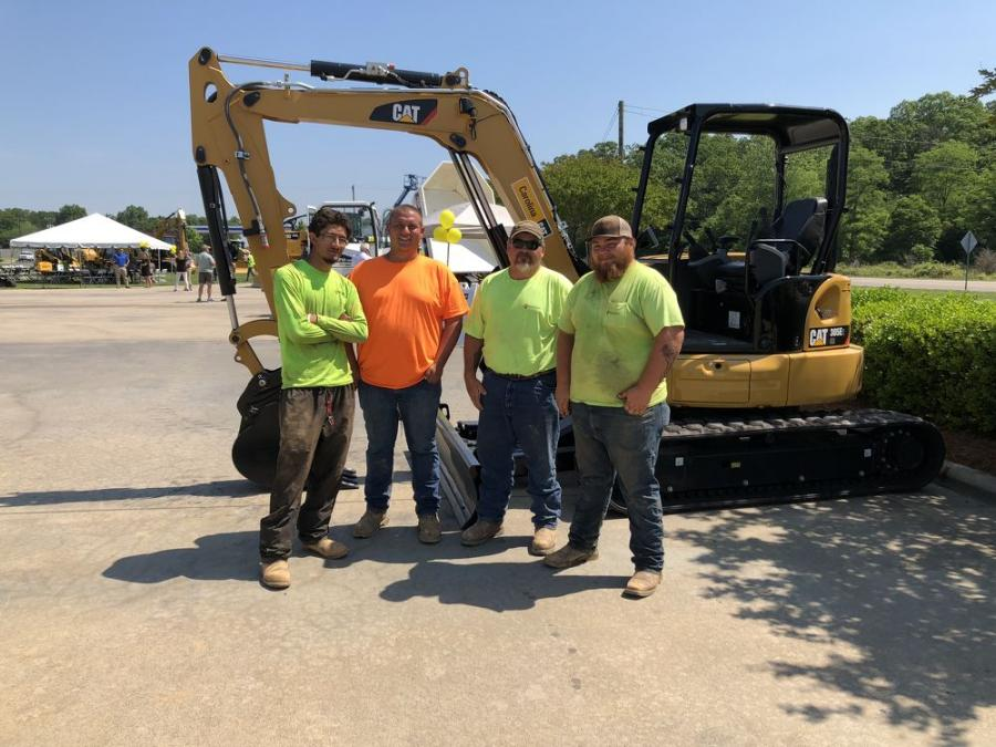 (L-R): Brandon Trent, Jakob Puskas, Chris Ramsey and David Marlowe, all of Thomson, Corder & Co Civil Contractors in Wilmington, N.C., take a look at this Cat 305E2 mini-excavator.