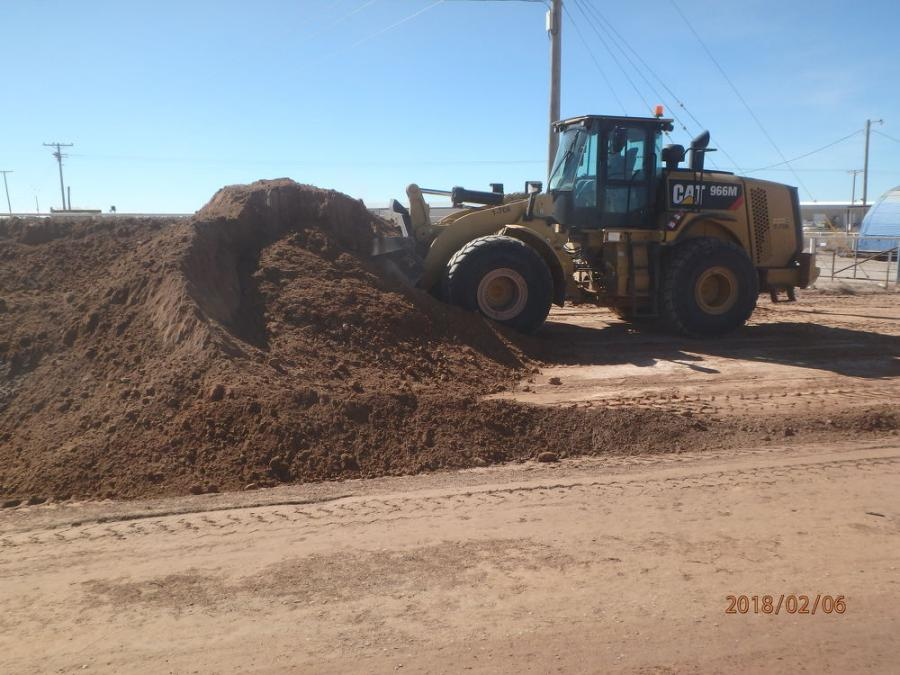 Fisher Sand & Gravel using a Cat 996M wheel loader to load borrow material for new lane construction.