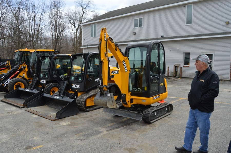 Alan Liguori of Chelmsford Landscaping Company, based in Lowell, Mass., looks over his JCB fleet..