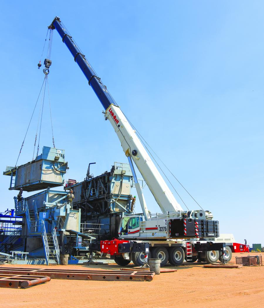 "Bar-S Services of Cheyenne, Wyo., lifts a 65,000 lb. (29,483 kg) ""sub"" on a box-on-box triple drill rig with its Link-Belt ATC-3275 all-terrain crane near Ault, Colo."