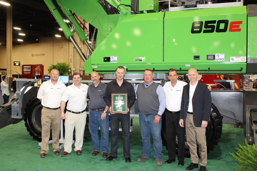(L-R) are Tim Hyland and Bill O'Keefe of Sennebogen; Eric Marburger, sales manager; Barry Talley, territory manager; Pat Sherwood, executive vice president of Midlantic Machinery; Constantino Lannes and Erich Sennebogen of Sennebogen.