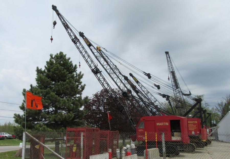 A lineup of cranes stands ready to be auctioned off at the sale.
