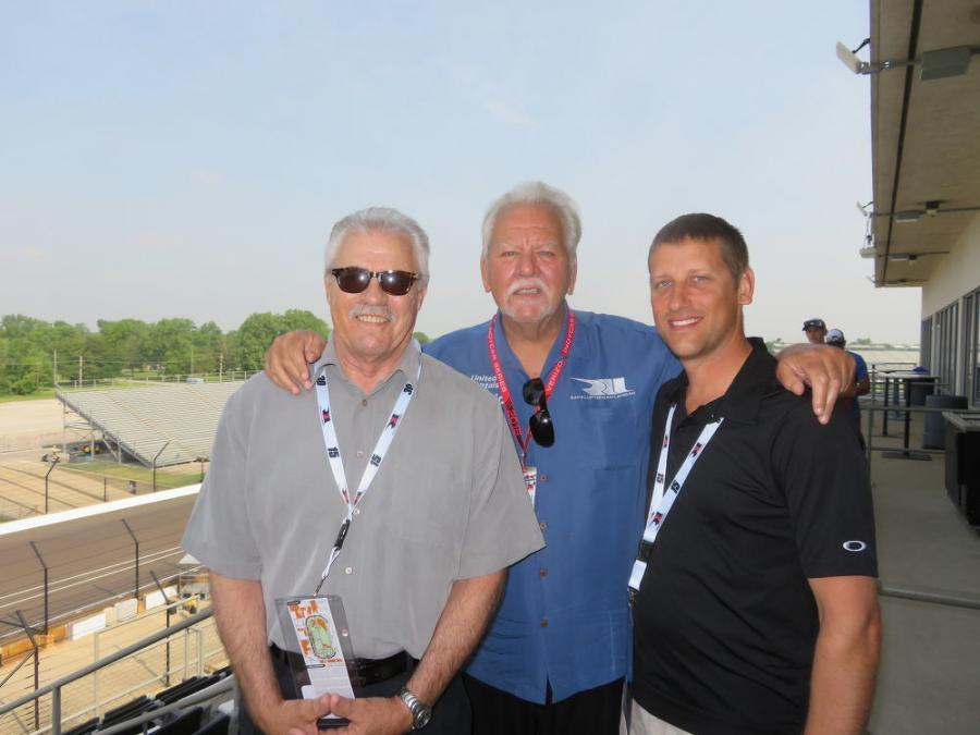 (L-R): Alan Johnson of Howell Tractor and Mike Lanigan, president of Mi-Jacks and co-owner of Rahal Letterman Lanigan Racing, welcome John Sicinski of Illinois Marine Towing to the Howell Tractor Pole Day.