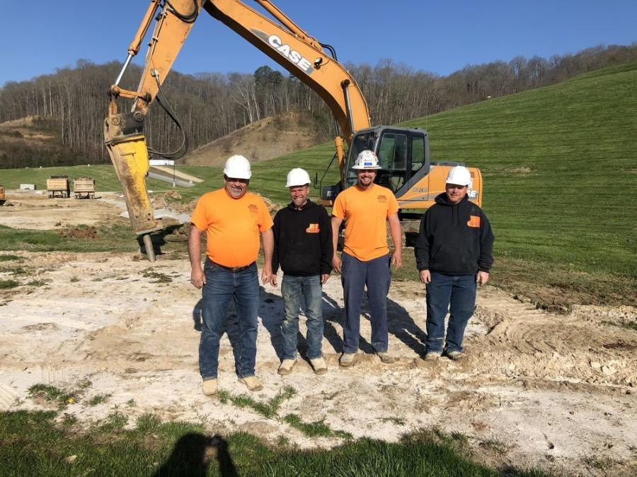 (L-R): Dwane Byrd, Mark Bollinger, Robert Fortner and Travis Carey, all of Byrd Construction, get to work using this Case CX210B with a hammer.