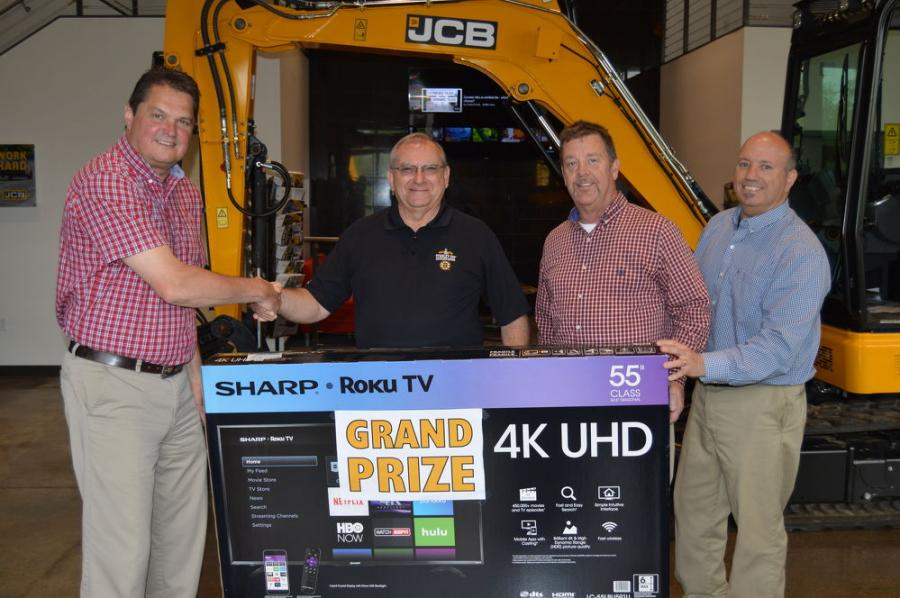 Bill Dorazio (second from L) of Colt Refining & Recycling, Merrimack, N.H., was the grand prize winner at the event. With him and his new Sharp 4K TV are Branch Manager Jeff Hawkins (L); Bill Spain (second from R), sales representative; and Kevin Blacker (R), service manager.