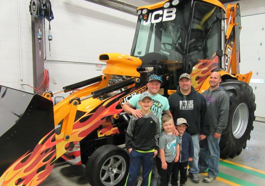 (L-R): Jacob, Mick and Dustin Hamilton, all of Hamilton Concrete, along with their kids Gavon, Jaxon and Lucus, admired the JCB GT at the event.