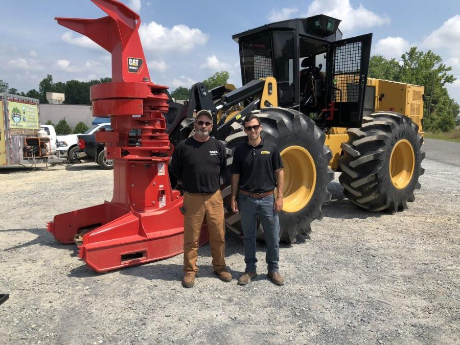 Alvin McNeill (L) of T.H. Blue Inc. in Eagle Springs, N.C. and Charlie Orr of Carolina Cat, stand in front of a Cat 563D feller buncher with a Cat HFW221 cutting head.
