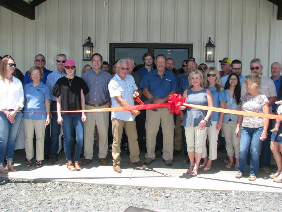 A great turnout of vendors and local dignitaries arrived to join owners Tim and Kimberly Moore and sales and service manager Kenny Wallace (C) for the official ribbon-cutting on June 7.