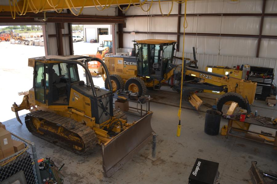 A John Deere 772 grader and 700J dozer await service in Beard Equipment's service bays. Beard services all major lines of equipment.