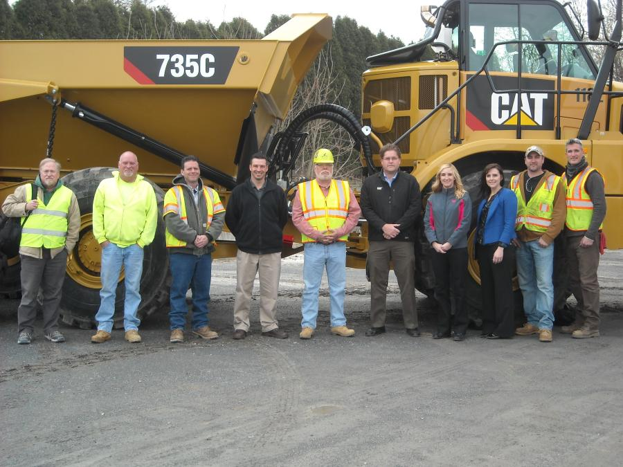 Key players from Schlouch and Foley pose in front of Schlouch's new Cat 735C articulated truck at the company's headquarters in Blandon, Pa.