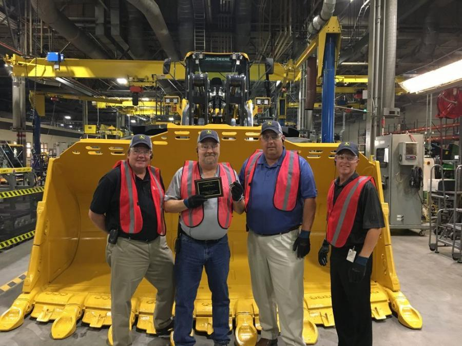 John Deere officials presented Dolomite Products with a special plaque and a commemorative Gold Key. (L-R) are Kenn Baker, Five Star Equipment; Harry Gorrell, Dolomite; Dave Johnson, Five Star Equipment; and Denny Vonnahme, John Deere.