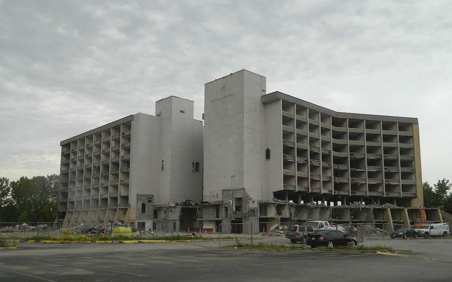 Closed in 2016, the former Park Place Hotel near Front Street and I-435 came tumbling down with the help of 500 lbs. of dynamite.