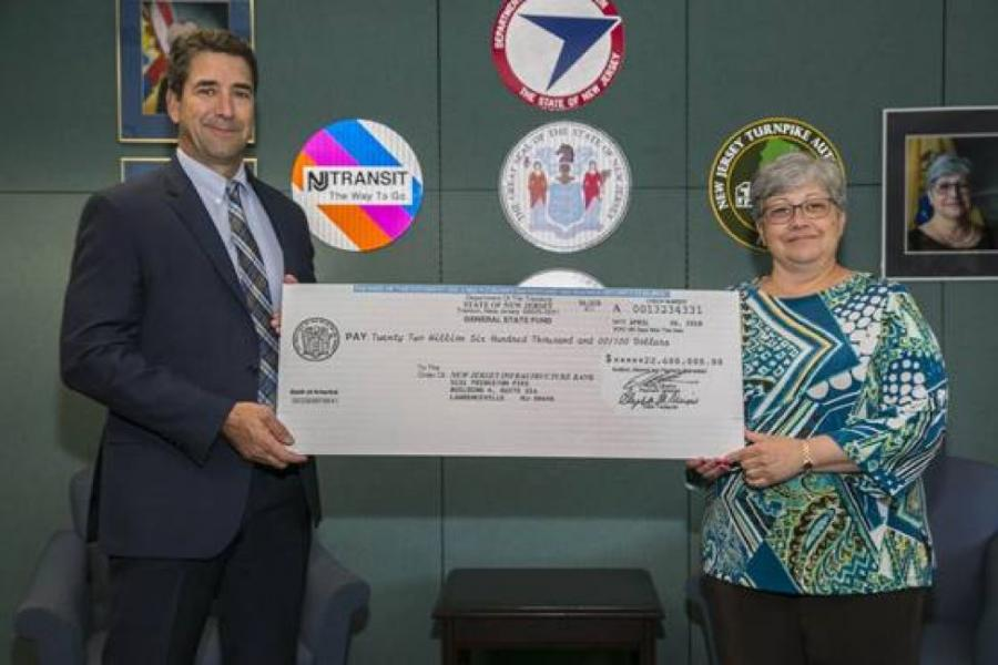 NJDOT Commissioner Diane Gutierrez-Scaccetti presents the I-Bank Vice-Chairman, Robert Briant Jr., with a $22.6 million check from the State Local Aid Infrastructure Fund, marking the launch of the New Jersey Transportation Bank.