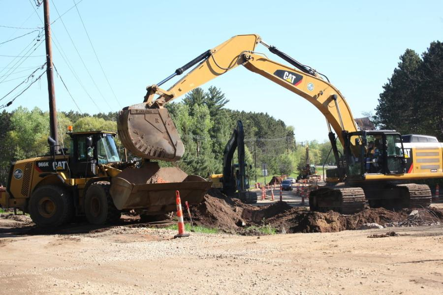 This Cat dozer pushes dirt along one of the 10 intersecting cross streets that were reconstructed as part of the contract.