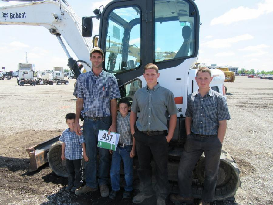 Noah Cross of Crosscut Tree Service along with his sons (L-R) Travis, Roger, Malvern and Marcus were pleased to have placed the winning bid on this Bobcat E80 compact excavator.