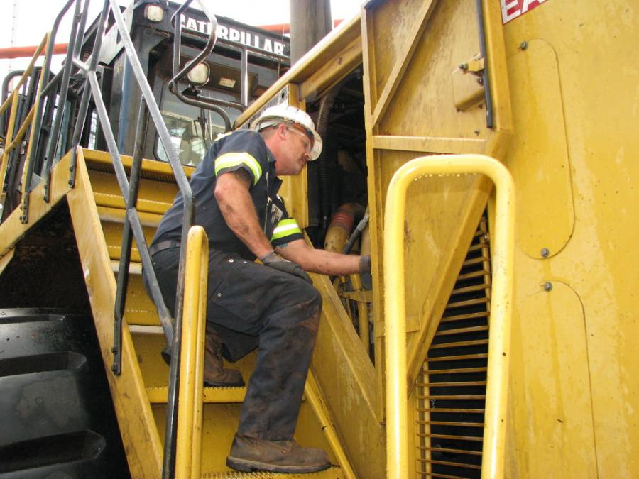 Mickey McKinnon, Yancey Bros. Co. field service representative, performs 500-hour interval work on International Paper's Cat 990H.