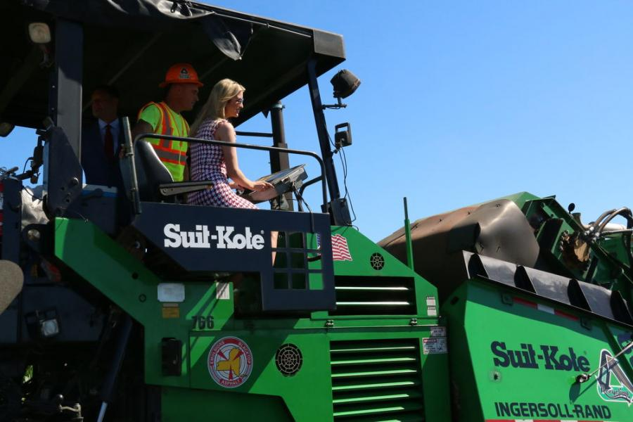 Trump joined Frank Suits Jr. and Rep. Tenney to witness a demonstration of a cold-in-place recycling project on Patriot Road leading into the Suit-Kote facility. Once the paver got into the mix, Trump jumped up on top and took the controls.