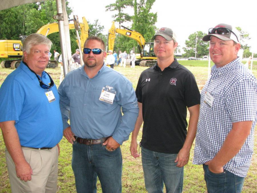 (L-R): Jay McCormack of Blanchard Machinery and Dave Arney, Paul King and Morris Livingston of King Construction Services Inc. in Myrtle Beach, S.C., talk about the new generation of hydraulic excavators being demonstrated at the event.