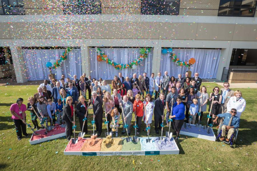 Patients and doctors were among those who turned out for the groundbreaking, which featured confetti, along with shovels dug into a rainbow of colored sand.