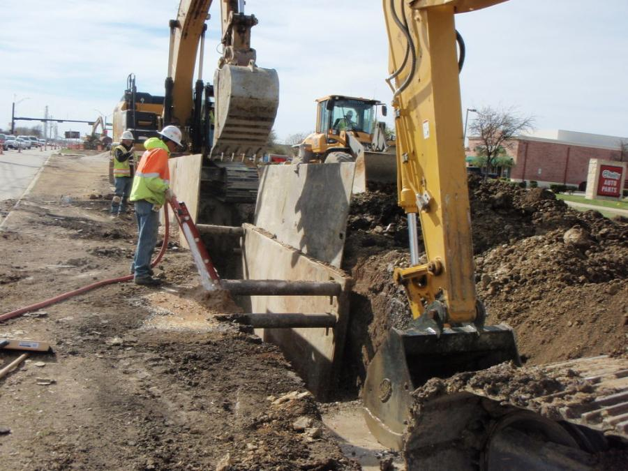 Installation of 30 ft. ductile iron water line beneath future inside lane of Main Street.