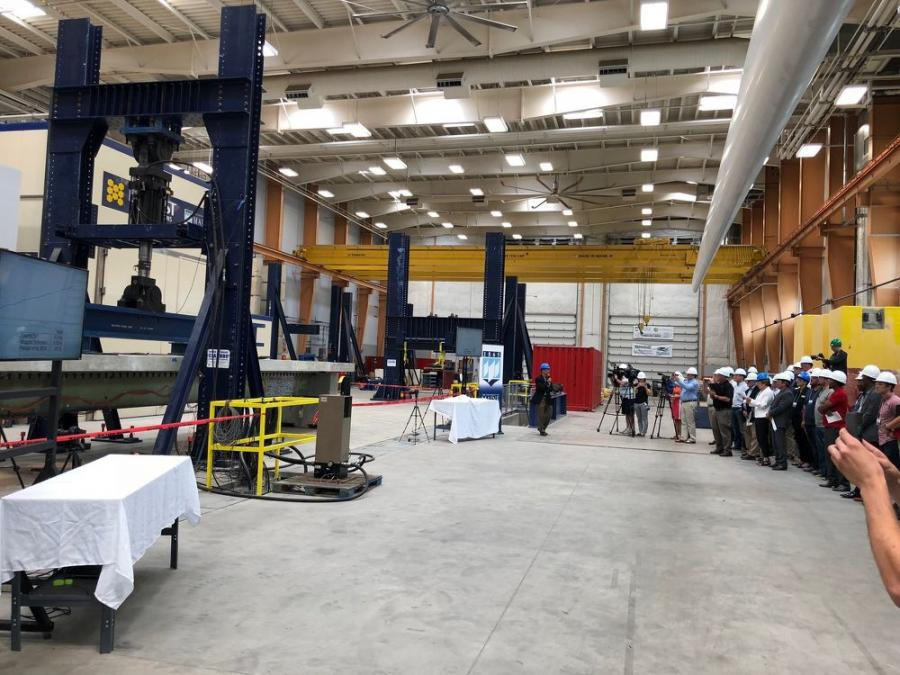 UMaine engineers perform a test on an innovative bridge girder made of composite materials with dozens of engineers, Maine DOT officials, business leaders, investors, researchers and staff in attendance.
