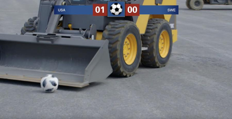 "With a referee looking on, expert operators maneuvered their skid steers around a ""field,"" scoring goals as they went."