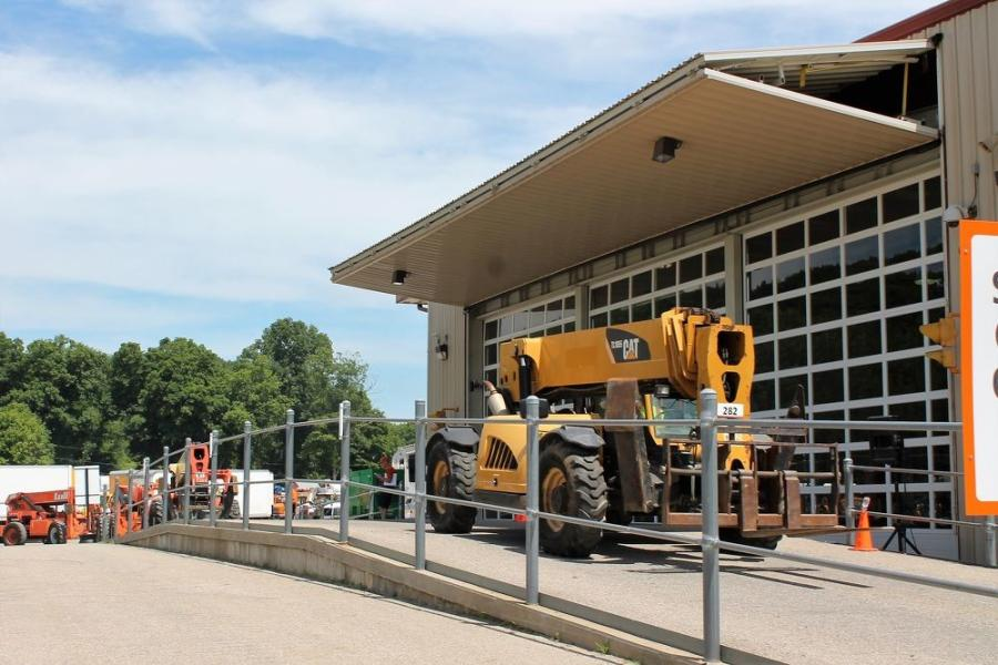 Ritchie's North Franklin, Conn., facility has a ramp that allows equipment to drive over while attendees can get a clear view of the machine in an air-conditioned, fully temperature-controlled building.