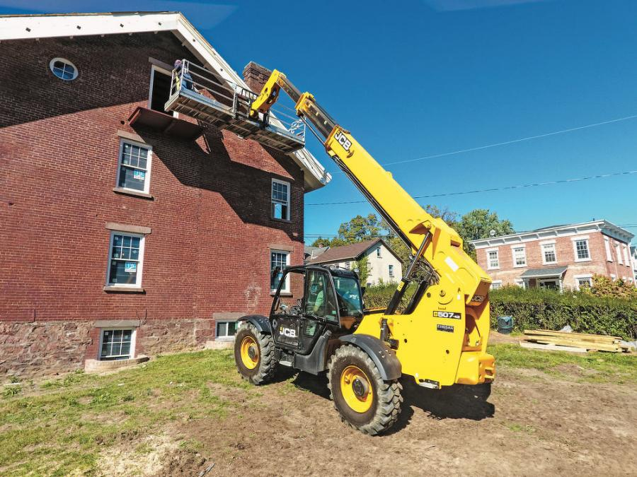 "A Beacon Residential operator uses the firm's JCB 507-42 telescopic handler on a job site in Beacon, N.Y. ""From unloading tractor-trailers, to placing sheathing, to moving dirt — it's a great all-around machine,"" said Owner Tim Owen. ""It's not too large, but it's not small. It can accommodate all our needs."""